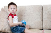 Asian boy with toy. — Stock Photo