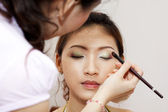 Applying makeup. — Stock Photo
