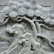 Chinese Feng Shui pine tree carving. - Stock Photo