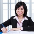Stock Photo: Asian woman working in office