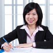Foto Stock: Asian woman working in office