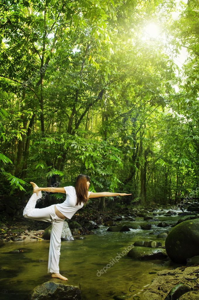 Female practises balancing at  nature tropical forest in a morning. — Stok fotoğraf #2654674