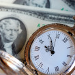 Stock Photo: Old pocket watch on $2 bills