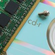 memory chip on a beautiful reflective cd — Stock Photo