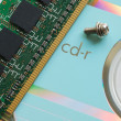 Stock Photo: Memory chip on beautiful reflective CD