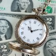 Old pocket watch on a stack of $2 bills — Stock Photo