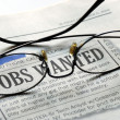 Stock Photo: Searching for a job from a newspaper