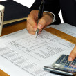 Stock Photo: Checking financial statement