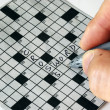 Solving the cross word puzzle - Photo