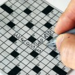 Solving the cross word puzzle - Foto de Stock
