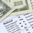 Money refunded on the tax return — Stock Photo