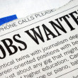 Searching for a job from a newspaper — Stock Photo