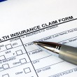 Filling the health insurance claim form — Stock Photo #2016923