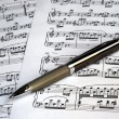 A pen on the top of music sheets — Stock Photo #2017092