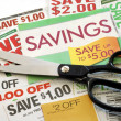 Cut up some coupons to save money — Stok fotoğraf