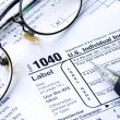Stock Photo: Working on the United States Income Tax