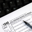 Filing the income tax return online - Stock Photo