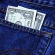 Stock Photo: Money in rear pocket of blue jeans