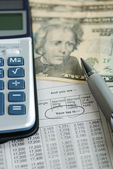 Calculator on the income tax table — Stock Photo