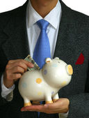 A gentleman deposits some money — Stock Photo