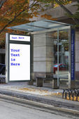 Bus stop with the advertisement removed — Stock Photo