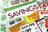 Cut up some coupons to save money — Стоковое фото