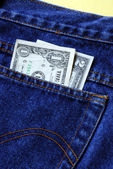 Money in the rear pocket of a blue jeans — Stock Photo