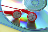 Listen music from a MP3 CD — Stock Photo