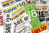 Cut up some coupons to save money — Stockfoto