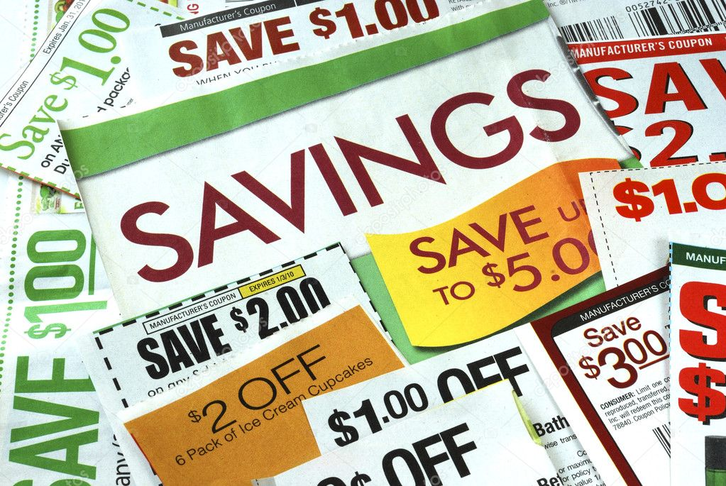 Cut up some coupons to save money   Stock Photo #2017074