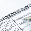 Stock Photo: File health insurance claim form