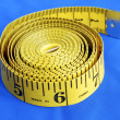 A coiled-like measuring tape — Stock Photo