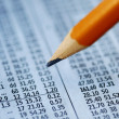 Check out the stock prices with a pencil — Stock Photo #2020862