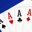 Four ace play cards isolated on blue — Photo
