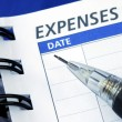 List out the expenses - Stock Photo