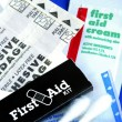 List of items in a First Aid Kit - Stock Photo