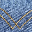 Denim material with curry seams — Stock Photo #2021245
