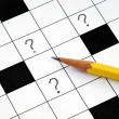 Crossword puzzle with question marks — Stock Photo