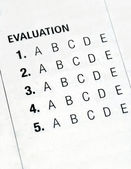 Filing the evaluation form — Stockfoto