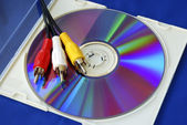 Three-color RCA video cables on a CD — Stock Photo