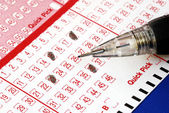 Filing the lottery ticket with a pencil — Stock Photo