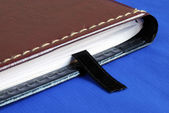 Brown notebook with a black bookmark — ストック写真