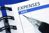 List out the expenses — 图库照片