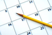 Planning the new month from a calendar — Stock Photo