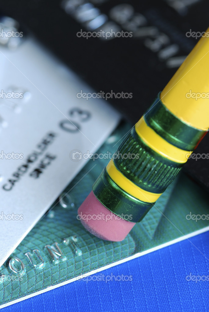 Erase the debt on the credit cards isolated on blue  Stock Photo #2021027