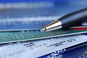Close up view of credit cards and pen — Stock Photo