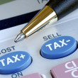 Stock Photo: Calculate tax and cost