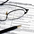 Fill the health insurance claim form - Stock Photo