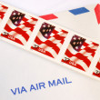 Some stamps on the top of an air mail en - Stock Photo