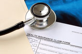A stethoscope on the medical claim form — Stock Photo